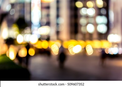Abstract bokeh background of business people meet at bar on happy hour