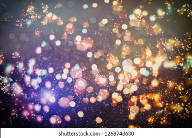 Abstract bokeh background. Christmas Glittering background. Abstract christmas background. Glittering Christmas background