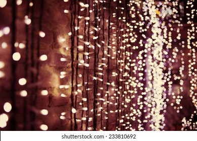 Abstract bokeh  background of Christmas lights. Toned image