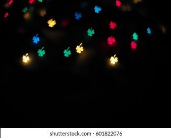 Abstract bokeh blurred color light ,Bokeh art, leaf clover shape, defocused background.