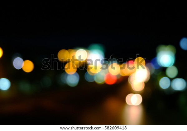 Abstract bokeh of car in city at night