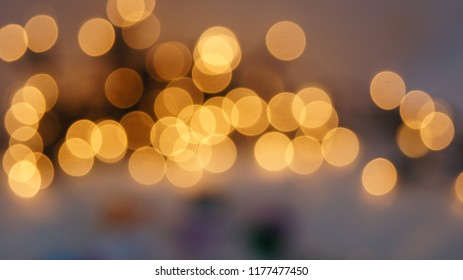 Abstract bokeh defocused circular facula background. Festive defocused lights.