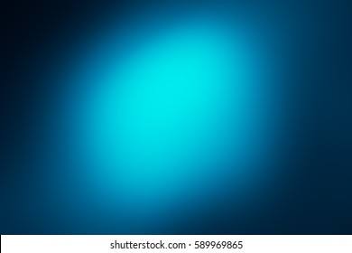 Abstract bokeh or glitter lights on blue  background. Circles and defocused particles. Design template