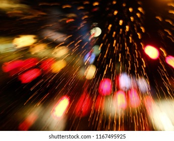 Abstract bokeh light background of city night with raining.