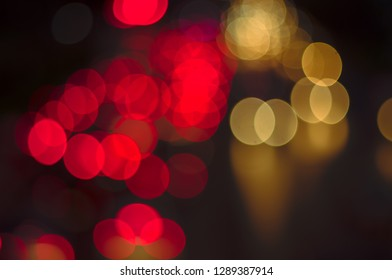 Abstract bokeh light fades neon, on black background and lighting illuminated from street,concept of beauty brightness of shine defocused,banner panoramic for web