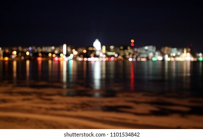 abstract bokeh night city lights backgroundsilhouette of madison skyline at night with out of