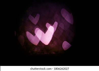 abstract bokeh pink Heart shaped background with glowing lights