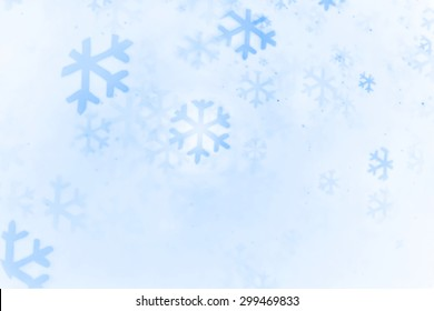 Abstract Bokeh Snowflake shapes background created by light and water spray. in blue color.