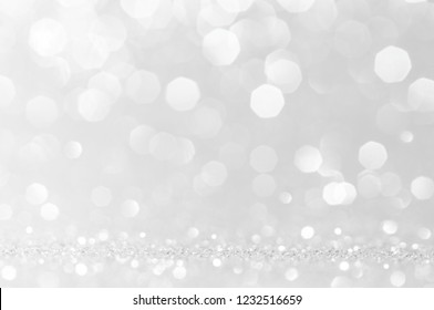 Abstract bokeh white,light grey,sliver colors de focused circular background.Night light season greeting elegance backdrop or artwork design for newyear,christmas sparkling glittering or special day.