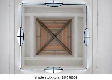 Abstract bottom up view of a roof structure