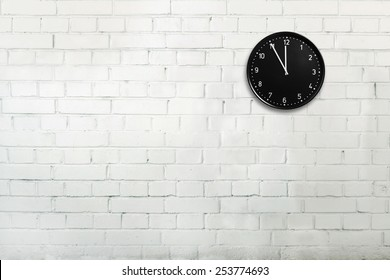Abstract brick wall with office clock