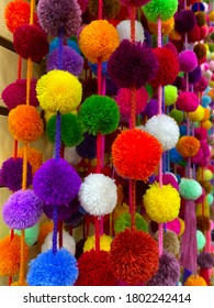 Abstract bright background.Vivid different colors balls of threads. The texture of the fluffy balls. Beautiful bright background. Vertical, close-up.
