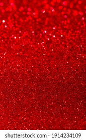 Abstract bright red glitter lights background. Circle blurred bokeh. Romantic backdrop for Christmas, Valentines day, womens day, holiday or event