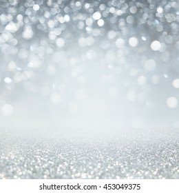 Abstract of Bright and sparkling bokeh background. silver and diamond dust bokeh -blurred lighting from glitter texture. Blue color Luxury design background.