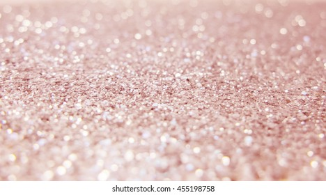 Abstract of Bright and sparkling bokeh background. Rose gold bokeh -blurred lighting from glitter texture.