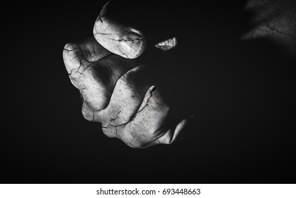 Abstract broken hand background - double exposure of human hand with cracked wall