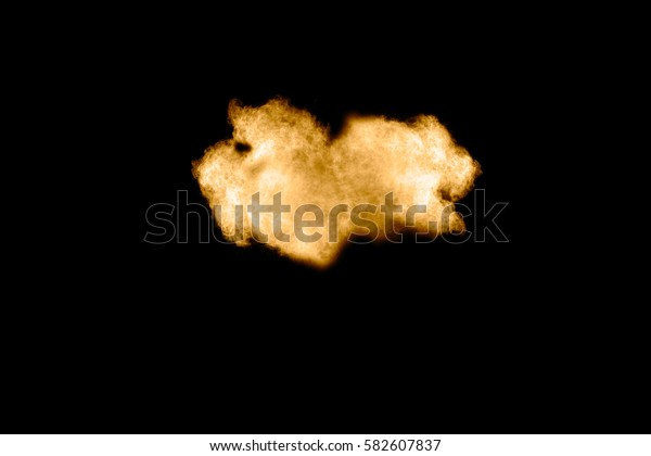 abstract brown dust explosion on  black background.abstract brown powder splatted on black background,Freeze motion of brown powder exploding