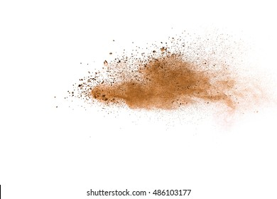 abstract brown powder splatted on white background