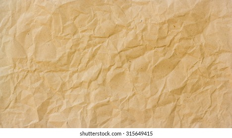 Abstract brown recycle crumpled paper for background : crease of brown paper textures backgrounds for design,decorative. paper textures concept.