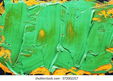 abstract brush stroke daub background green and yellow  oil paint on a dark  palette