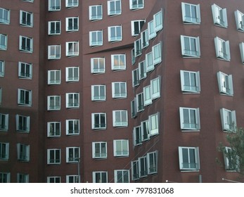 Abstract building. Asymmetric and symmetrical windows.