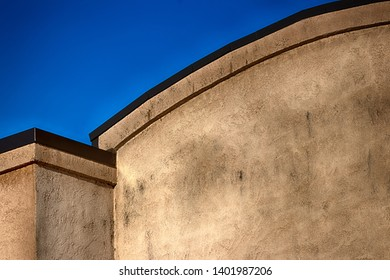 Abstract building wall with blue sky in daylight