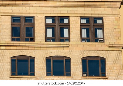 Abstract building wall with windows in daylight