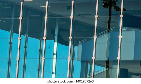 Abstract building window glass with blue sky and reflection