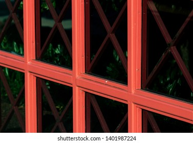 Abstract building window glass with red panes in daylight