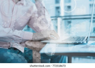 Abstract business concept blue tone with business man using computer. Double exposure with different grapic lines, blur and flare.