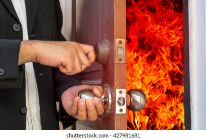 abstract business man will close the door for shut fire burn - can use to display or montage product or concept of hell door