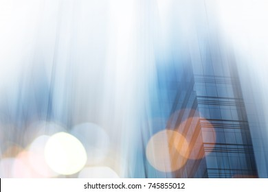 Abstract business modern city urban futuristic architecture background. Real estate concept, motion blur, reflection in glass of high rise skyscraper facade, toned blue picture with bokeh