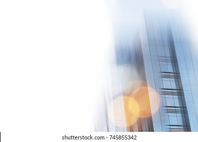 Abstract business modern city urban futuristic architecture background. Real estate concept, motion blur, reflection in glass of high rise skyscraper facade, toned blue picture with bokeh on white