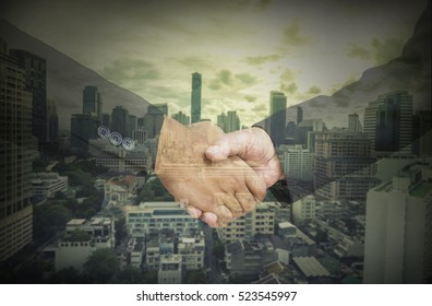 abstract businessman shakehand for commitment business with vignette filter for corruption idea - can use to display or montage on product