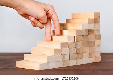 Abstract businesswoman climbing stairs. Hand stepping up wooden ladder. Business start up concept