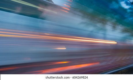 abstract of busy traffic under the expressway at night in Bangkok city, Thailand