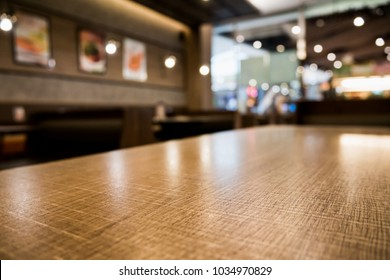 Abstract cafe coffee shoop restaurant table with blur background with bokeh light