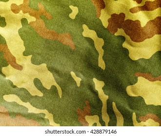 Abstract camouflage cloth texture. Background and texture for design.