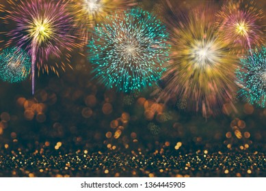 Abstract celebration background with colorful fireworks and bokeh lights. Holiday layout design for event party.