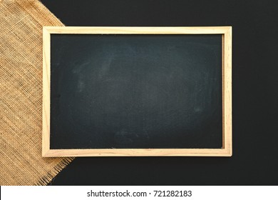 Abstract chalk blackboard with chalk scratch on sack fabric , ready used as background for add text or graphic
