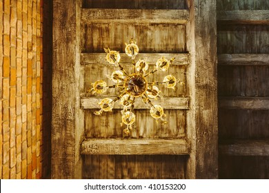 Abstract chandelier light decoration design on wooden ceiling and brick wall