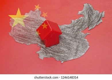 Abstract China paper map with little plastic house.