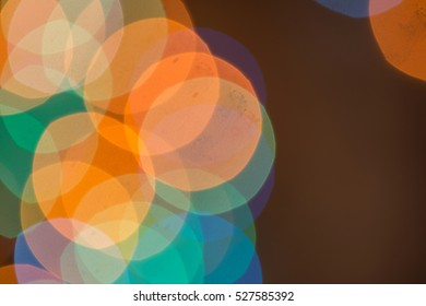 Abstract of Christmas background of defocused lights with decorated tree