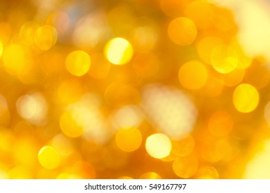 Abstract Christmas background with gold bokeh lights and place for text. Beautiful Festive textured background. Vintage defocused background