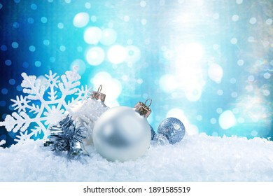 Abstract Christmas Baubles On Snow With Fir Branches