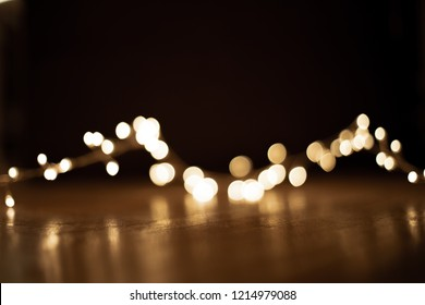 Abstract christmas lights on  black  background. Defocused  Glowing light bulb garland, copyspace