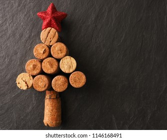 Abstract Christmas tree of bottle cork on a dark slate background with space for text