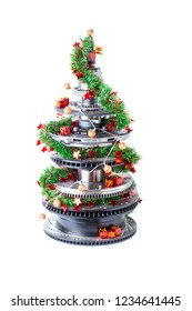 Abstract christmas tree of car parts on a white background. Decorated with Christmas toys, garland