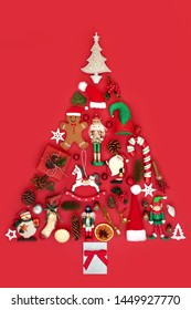 Abstract Christmas tree decoration with winter flora, baubles, ornaments and symbols on red background. Traditional theme with symbols for the festive season.