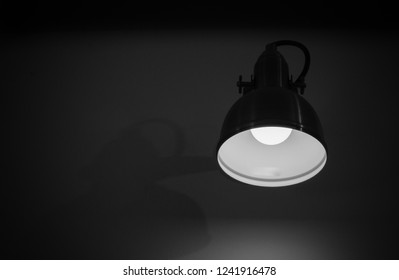 Abstract circle lamp on the wall with light blub in black and white background with copy space.